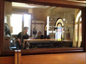 Looking in at The Stikman and assistant engineer Tristan Baccus at the Board in the control room at Polymorph.