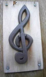 The old Polymorph Studio B G-clef door-knocker by Gabrielle Curry