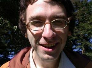 Rob Reich's asymmetrical grin